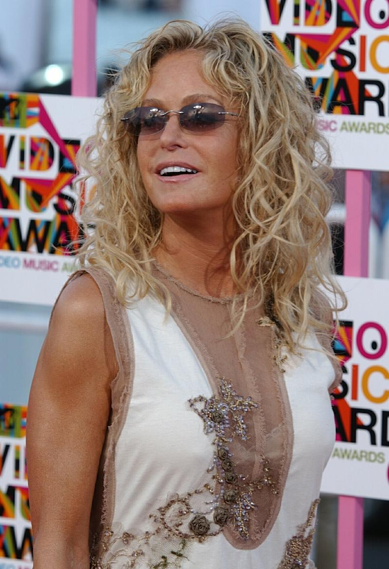 FILE- In this Aug. 29, 2004 file photo, actress Farrah Fawcett arrives for the  MTV Video Music Awards in Miami. The University of Texas system sued Fawcett's longtime partner, Ryan O'Neal, asking that a federal judge order him to turn over an Andy Warhol painting of the model and actress that they claim he is keeping without permission. (AP Photo/Chris O'Meara, file)