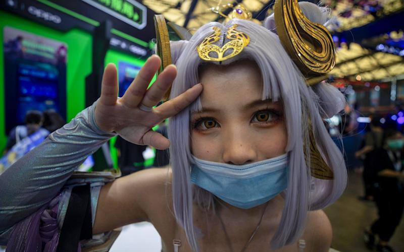 A woman in costume poses in the ChinaJoy gaming expo in Shanghai, China, in which Tencent has a huge presence - ALEX PLAVEVSKI/EPA-EFE/Shutterstock/Shutterstock