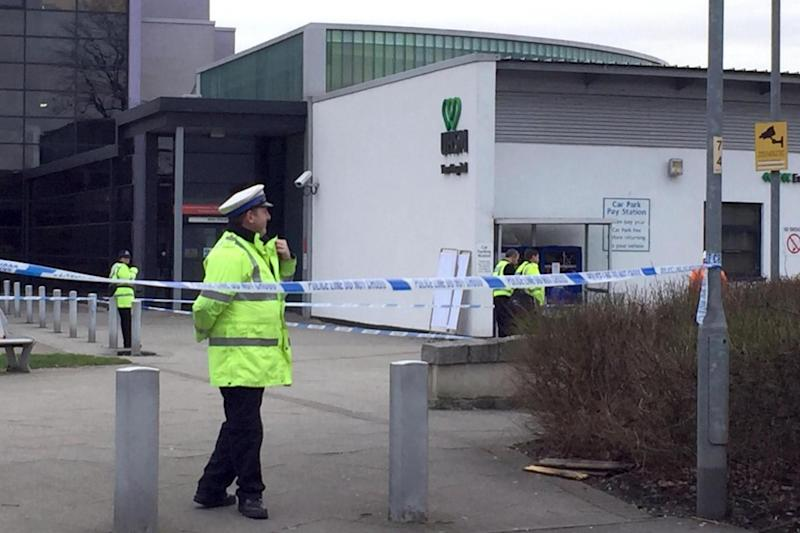 Police stand guard at a cordon outside a hospital in Manchester (PA)