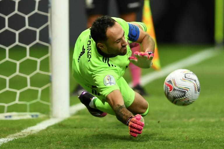Colombia goalkeeper David Ospina saves a shoot-out penalty from Uruguay's Jose Gimenez during the 2021 Copa America quarter-final