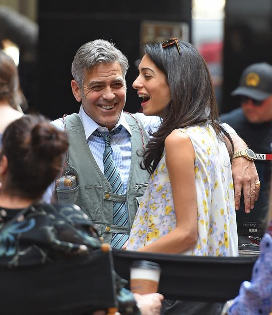 George and Amal Clooney laugh on the set of George's movie 'Money Monster' in April (Getty Images)