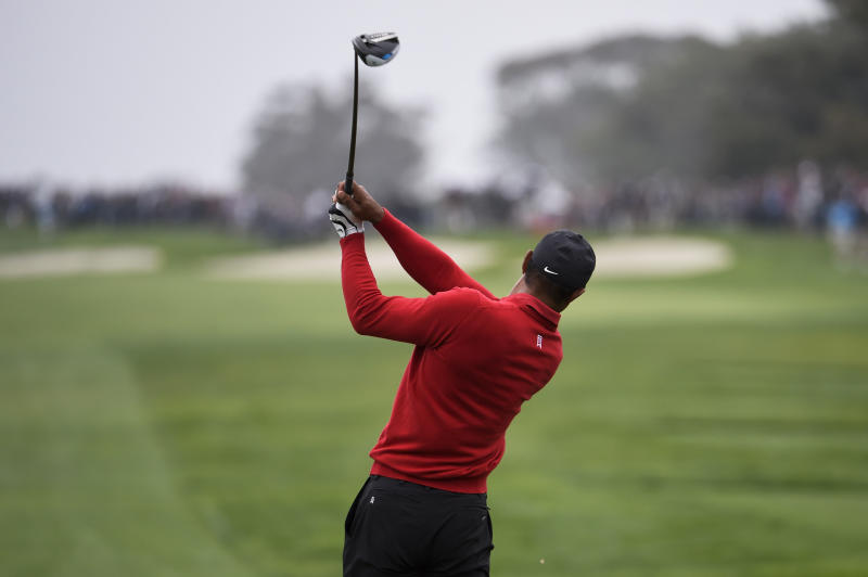 Tiger Woods hits his tee shot on the fourth hole of the South Course at Torrey Pines Golf Course during the final round of the Farmers Insurance golf tournament Sunday Jan. 26, 2020, in San Diego. (AP Photo/Denis Poroy)
