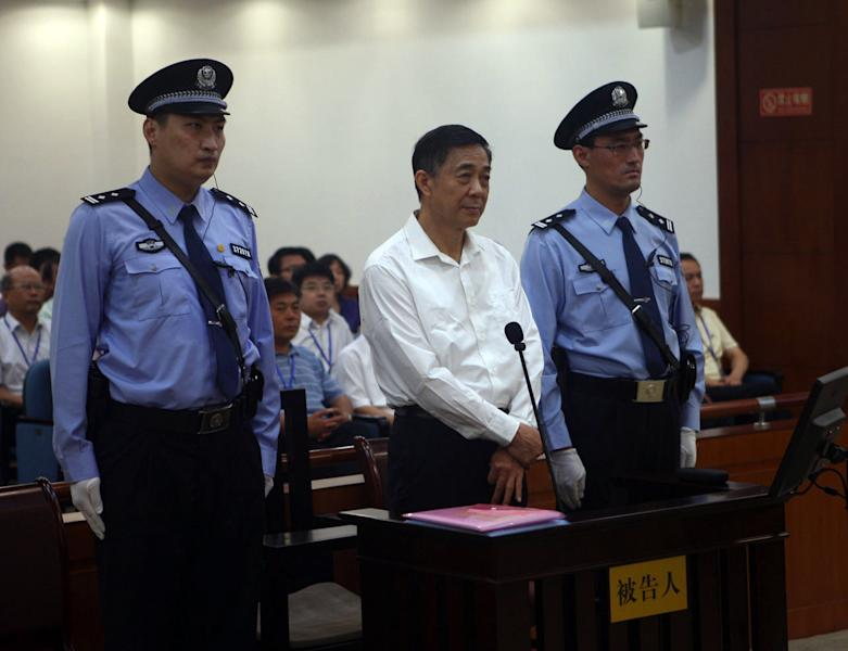 In this photo released by the Jinan Intermediate People's Court, Bo Xilai, center, stands on trial at the court in eastern China's Shandong province on Thursday Aug. 22, 2013. Disgraced populist politician Bo Xilai went on trial Thursday accused of abuse of power and netting more than $4 million in bribery and embezzlement, marking the ruling Communist Party's attempts to put to rest one of China's most lurid political scandals in decades. (AP Photo/Jinan Intermediate People's Court)