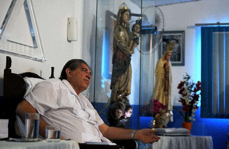 Brazilian medium Joao de Deus (John of God), pictured in 2012, is accused of making women perform sex acts during one-on-one sessions in which he claimed he was using his supernatural powers to cure them (AFP Photo/PEDRO LADEIRA)