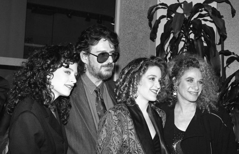 Gerry Goffin (second left) and Carole King (far right) pose with their daughters Louise Goffin (far left) and Sherry Goffin Kondor in 1988. (Photo: Donna Santisi/Redferns)