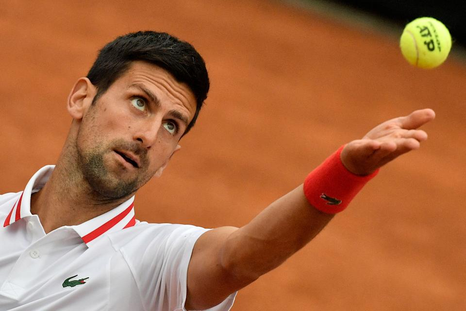 Serbia's Novak Djokovic serves to USA's Taylor Fritz during their first round match of the Men's Italian Open at Foro Italico on May 11, 2021 in Rome, Italy. (Photo by Filippo MONTEFORTE / AFP) (Photo by FILIPPO MONTEFORTE/AFP via Getty Images)