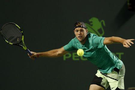 Mar 29, 2017; Miami, FL, USA; Jack Sock of the United States reaches for a forehand against Rafael Nadal of Spain (not pictured) on day nine of the 2017 Miami Open at Crandon Park Tennis Center. Nadal won 6-2, 6-3. Mandatory Credit: Geoff Burke-USA TODAY Sports
