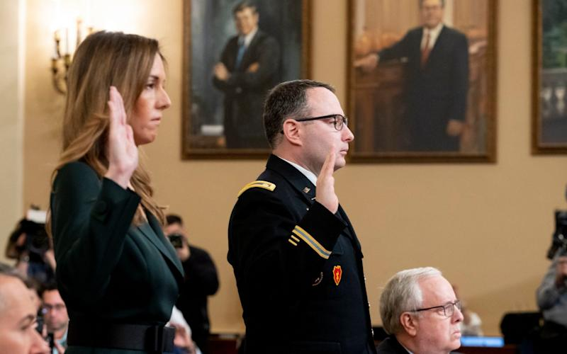 Jennifer Williams and Lt Col Alexander Vindman were sworn in on Capitol Hill on Tuesday - REX