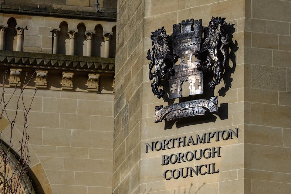 NORTHAMPTON, UNITED KINGDOM - FEBRUARY 15:  The Northampton Borough Council sign is seen on the County Hall in the town centre on February 15, 2018 in Northampton, United Kingdom.  Northamptonshire County Council has banned all new spending after announcing an overspend of £21m for the 2017-18 period. As it attempts to pay off £150m of loans, the council is looking at selling it's new £53m headquarters at One Angel Square, which was only opened in October 2017.  (Photo by Leon Neal/Getty Images)