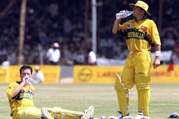 Steve and Mark Waugh of Australia take a drinks break in the game against Kenya during the cricket world cup match in Vishkatapatnum, India.