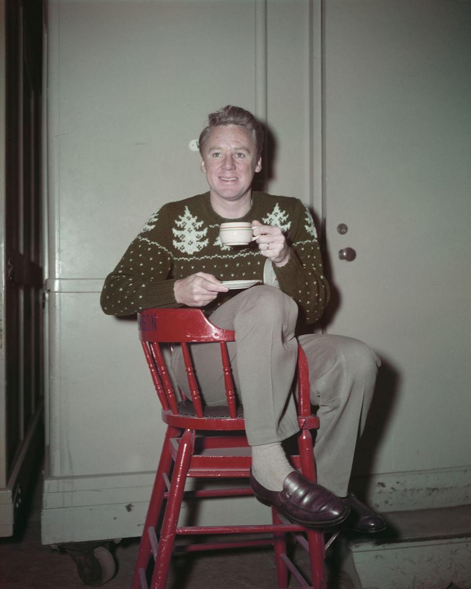 <p>Nothing beats a festive fair isle sweater and brown leather loafers on Christmas. Except the hot cocoa we imagine the actor was drinking here on set.</p>