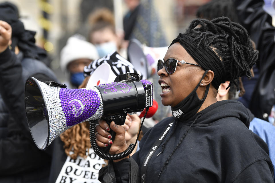 A protester speaks to the crowd gathered at Jefferson Square Park on the one year anniversary of the death of Breonna Taylor in Louisville, Ky., Saturday, March 13, 2021. (AP Photo/Timothy D. Easley)