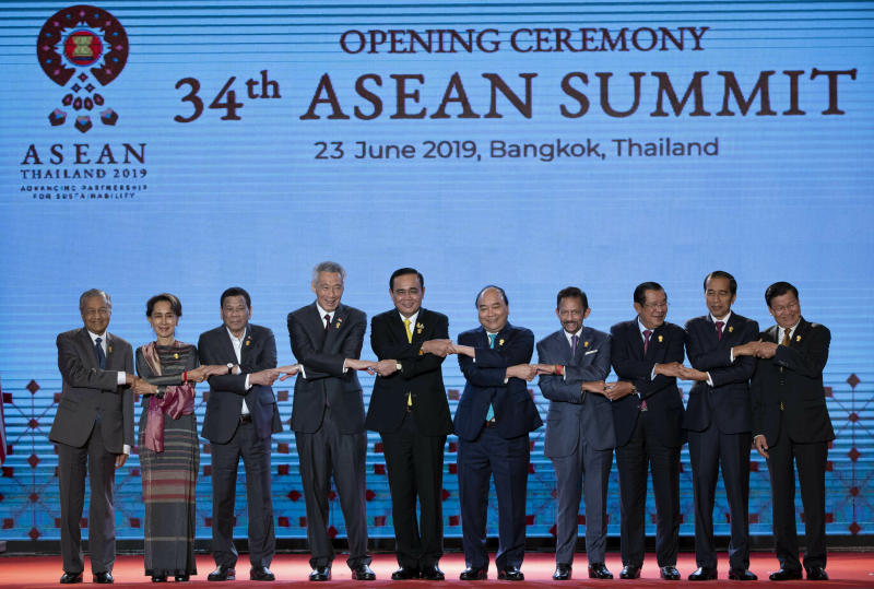 Leaders of the Association of Southeast Asian Nations (ASEAN) from left, Malaysian Prime FILE - In this June 23, 2019, file photo, South East Asian leaders pose for a group photo during the opening ceremony of the ASEAN leaders summit in Bangkok, Thailand. Southeast Asian leaders have pressed their call for self-restraint in the South China Sea as chief claimant China feuds with the U.S. over trade and territorial disputes flare anew between Beijing and the Philippines. (AP Photo/Gemunu Amarasinghe, File)