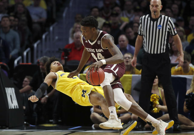 Texas A&M forward Robert Williams (44) drives against Michigan guard Jordan Poole during the first half of an NCAA men's college basketball tournament regional semifinal Thursday, March 22, 2018, in Los Angeles. (AP Photo/Jae Hong)