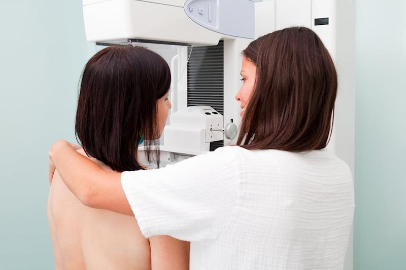 Nurse with patient having a mammogram