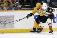 Nashville Predators left wing Viktor Arvidsson (33), of Sweden, and Anaheim Ducks defenseman Hampus Lindholm (47), of Sweden, vie for the puck during the second period of an NHL hockey game Tuesday, Oct. 22, 2019, in Nashville, Tenn. (AP Photo/Mark Zaleski)