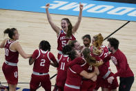 Indiana celebrate their win over North Carolina State in a college basketball game in the Sweet Sixteen round of the women's NCAA tournament at the Alamodome in San Antonio, Saturday, March 27, 2021. (AP Photo/Eric Gay)