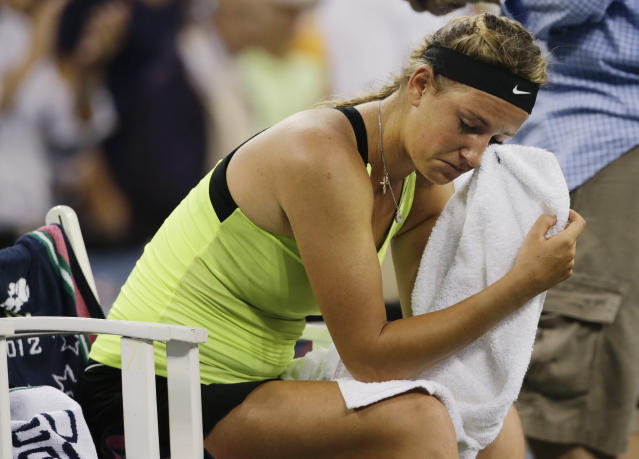 Victoria Azarenka, of Belarus, reacts after losing to Serena Williams in the championship match at the 2012 US Open tennis tournament, Sunday, Sept. 9, 2012, in New York. Two points from defeat, Williams suddenly regained her composure to come back and win the last four games, beating No. 1-ranked Azarenka 6-2, 2-6, 7-5 on Sunday for her fourth U.S. Open title and 15th Grand Slam title overall. (AP Photo/Charles Krupa)