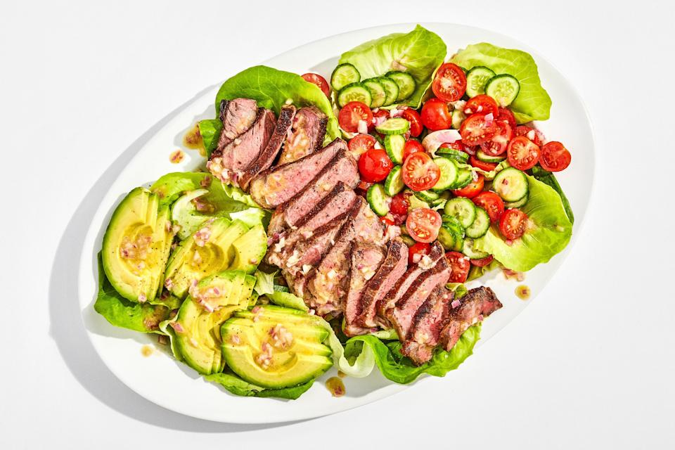 """Crusty, juicy sliced steak + a fully-loaded salad = what we want to eat most nights of the week, TBH. If searing a steak to perfect medium-rare makes you nervous, we get it! It takes practice, and even seasoned cooks can have a hard time divining the doneness of meat. Our advice? Invest in a decent quality <a rel=""""nofollow noopener"""" href=""""https://www.thermoworks.com/ThermoPop"""" target=""""_blank"""" data-ylk=""""slk:instant-read thermometer"""" class=""""link rapid-noclick-resp"""">instant-read thermometer</a> to help take the guesswork out of the equation. As for that zippy shallot vinaigrette, do yourself a favor and make a double batch—it'll keep for a week, and is a great dressing for simple salads, grain bowls, and all kinds of cooked meats. This recipe is a part of the <a rel=""""nofollow noopener"""" href=""""https://www.bonappetit.com/collection/basically-10x10?mbid=synd_yahoo_rss"""" target=""""_blank"""" data-ylk=""""slk:Basically 10x10"""" class=""""link rapid-noclick-resp"""">Basically 10x10</a>, a collection of ten essential, no-fail recipes that every home cook should have in their arsenal. <a rel=""""nofollow noopener"""" href=""""https://www.bonappetit.com/recipe/steak-salad-with-shallot-vinaigrette?mbid=synd_yahoo_rss"""" target=""""_blank"""" data-ylk=""""slk:See recipe."""" class=""""link rapid-noclick-resp"""">See recipe.</a>"""