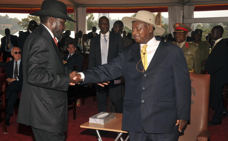 Uganda's President Yoweri Museveni, right, who took power by force in 1986 and has ruled since, receives South Sudan President Salva Kiir, left, at a ceremony to celebrate the 50th anniversary of the country's independence from British rule, in Kampala, Uganda, Tuesday, Oct. 9, 2012. The East African country has come a long way from the days when brutal dictators were in charge, but it has not had a single peaceful transfer of power since 1962, and the potential for instability remains as opposition activists intensify their campaigns and authorities clamp down. (AP Photo/Stephen Wandera)