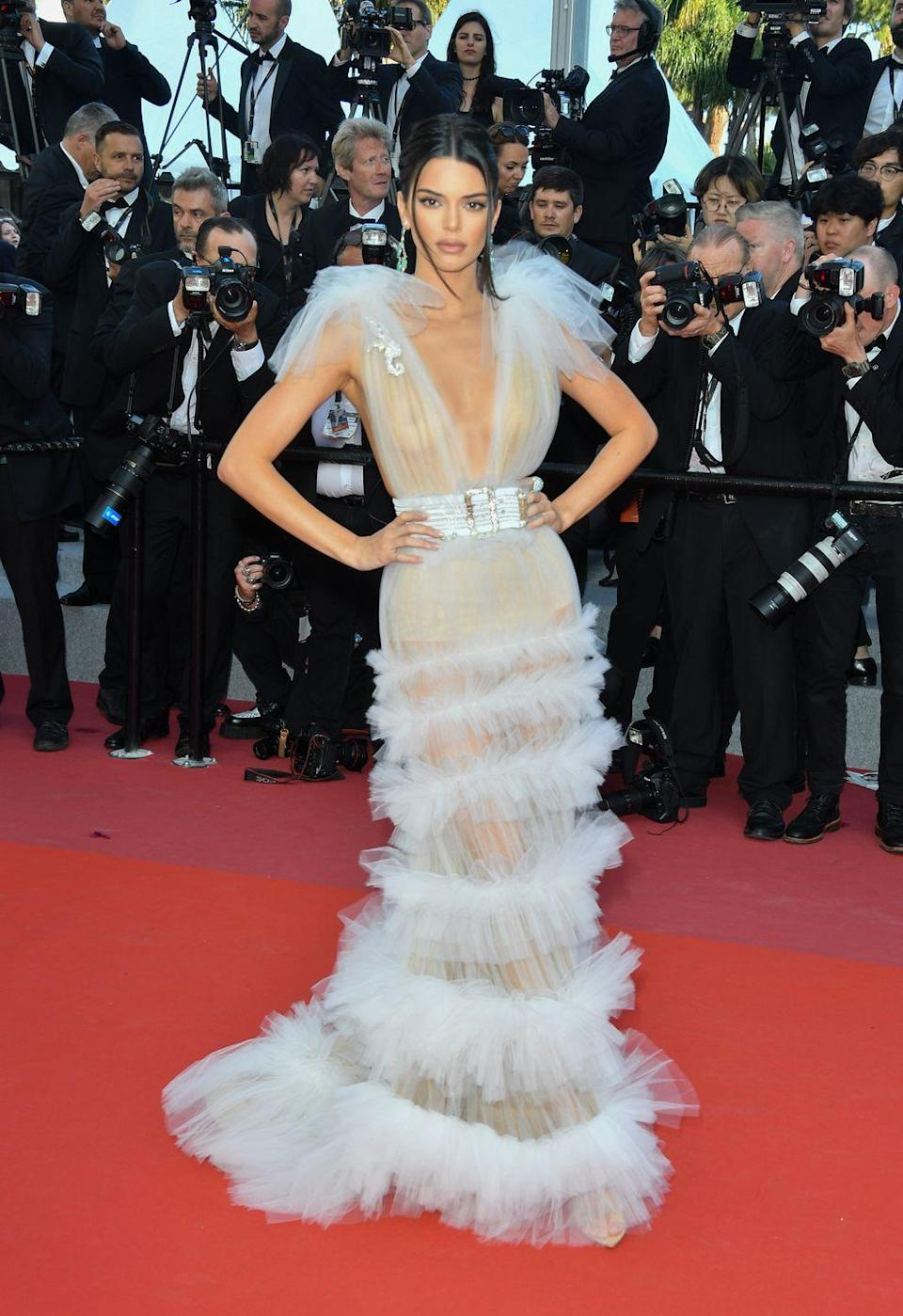 """<p>The star wore a sheer <span class=""""redactor-unlink"""">Schiaparelli Haute Couture</span> dress with exaggerated shoulder detailing on the red carpet at Cannes Film Festival. </p>"""