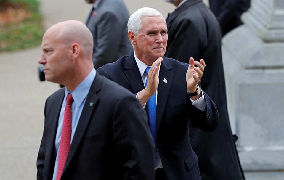 U.S. Vice President Mike Pence reacts to supporters outside the New Hampshire State House as he walks near his Chief of Staff Marc Short (L) after Pence filed candidacy papers for President Donald Trump to appear on the 2020 New Hampshire primary election ballot in Concord, New Hampshire, U.S., November 7, 2019. Picture taken November 7, 2019. REUTERS/Mike Segar