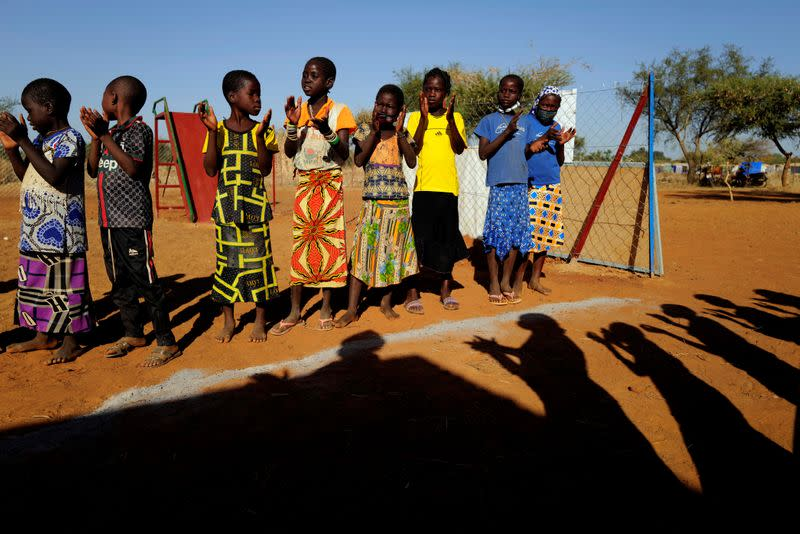 FILE PHOTO: Children who fled from attacks by Islamist militants in the Sahel region play at a camp for internally displaced people (IDPs) in Kaya, Burkina Faso
