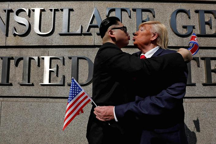 <p>Dennis Alan of Chicago, 66, who is impersonating U.S. President Donald Trump, and Howard, 37, an Australian-Chinese who is impersonating North Korean leader Kim Jong-un, pose outside U.S. Consulate in Hong Kong, China Jan. 24, 2017. (Photo: Bobby Yip/Reuters) </p>