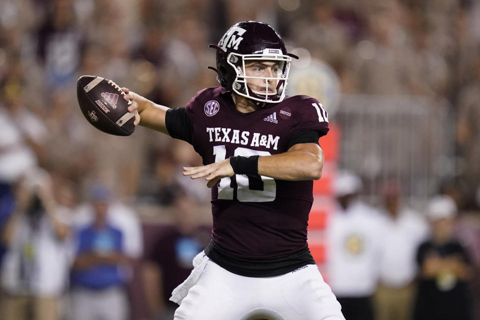 Texas A&M quarterback Zach Calzada looks for a receiver during the first half of the team's NCAA college football game against Alabama on Saturday, Oct. 9, 2021, in College Station, Texas. (AP Photo/Sam Craft)