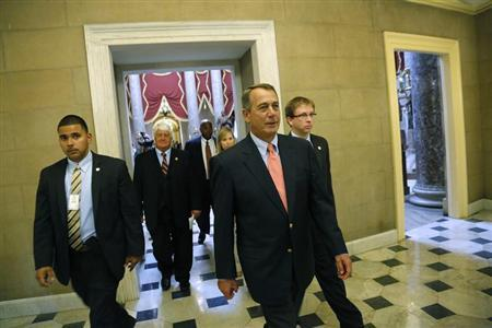 Boehner returns to his office after a unanimous House vote to retroactively pay furloughed government workers once the current government shutdown ends, at the U.S. Capitol in Washington