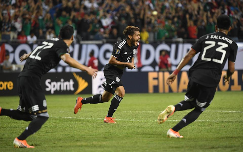 Jul 7, 2019; Chicago, IL, USA; Mexico midfielder Jonathan Dos Santos (6) celebrates after scoring a goal against the United States in the second half championship match of the CONCACAF Gold Cup soccer tournament at Soldier Field. Mandatory Credit: Mike DiNovo-USA TODAY Sports