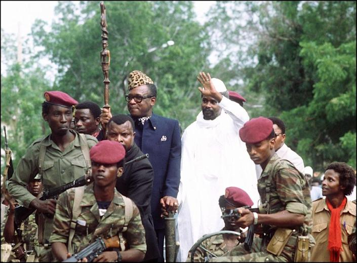 Mobutu Sese Seko, then president of Zaire (l), and Hissene Habré, then president of Chad, wave to wellwishers, 20 August 1983, in N'djamena (AFP Photo/Joel Robine)