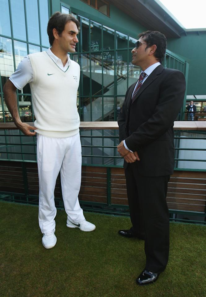 LONDON, ENGLAND - JUNE 25:  Cricket player Sachin Tendulkar (R) speaks with tennis player Roger Federer on Day Six of the Wimbledon Lawn Tennis Championships at the All England Lawn Tennis and Croquet Club on June 25, 2011 in London, England.  (Photo by Oli Scarff/Getty Images)