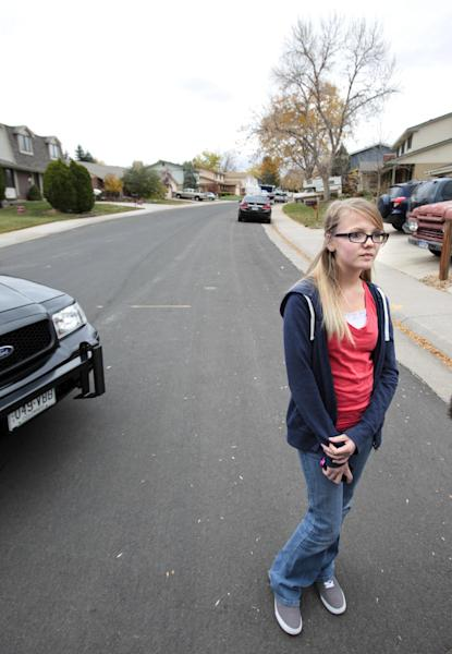 """Brooke Olds, 13, stands on the street where she would play frequently, see or talk to Austin Reed Sigg who she knew since she was four years old. """"He (Sigg) would play capture the flag with us. He always wanted to hang out with us girls, """" Olds said. Sigg lived down the street from Olds and was arrested for the murder of Jessica Ridgeway Wednesday, Oct. 24, 2012 in Westminster, Colo. (AP Photo/Barry Gutierrez)"""