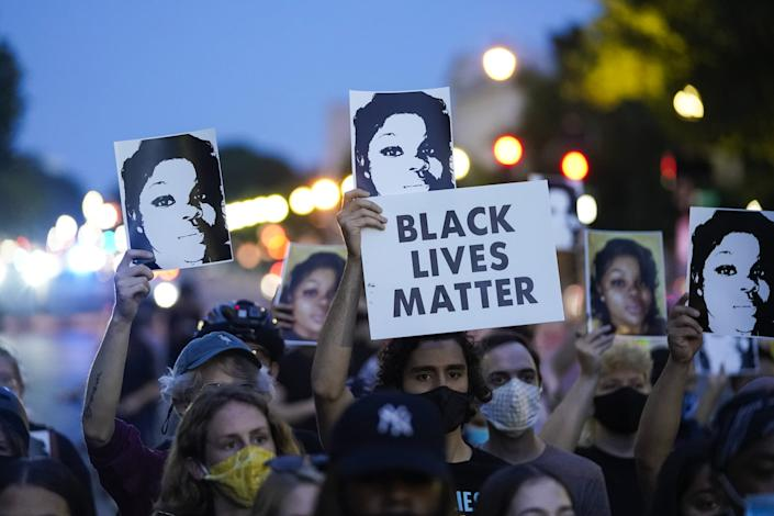 WASHINGTON, DC - SEPTEMBER 23: Demonstrators march along Constitution Avenue in protest following a Kentucky grand jury decision in the Breonna Taylor case on September 23, 2020 in Washington, DC. A Kentucky grand jury indicted one police officer involved in the shooting of Breonna Taylor with 3 counts of wanton endangerment. No officers were indicted on charges in connection to Taylor's death. (Photo by Drew Angerer/Getty Images)