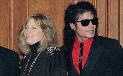 Barbra Streisand and Michael Jackson attend a ceremony together in 1986 - Credit: Mark Avery/AP