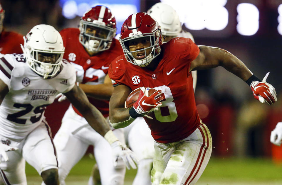 Alabama running back Josh Jacobs (8) carries the ball during the second half of an NCAA college football game against Mississippi State, Saturday, Nov. 10, 2018, in Tuscaloosa, Ala. Alabama won 24-0. (AP Photo/Butch Dill)