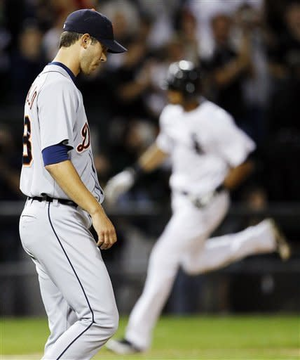 Detroit Tigers starting pitcher Rick Porcello, left, returns to the mound after giving up a three-run home run to Chicago White Sox's Alex Rios, rear, during the sixth inning of a baseball game, Monday, Sept. 10, 2012, in Chicago. (AP Photo/Charles Rex Arbogast)