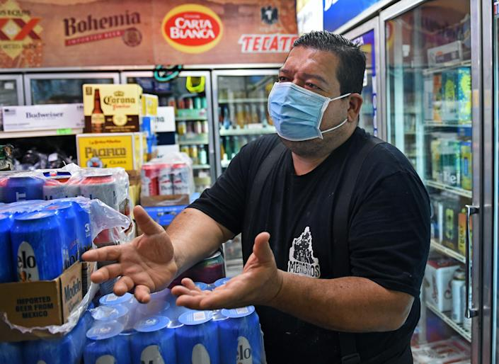 South Lake Tahoe business owner Andres Delgadillo expresses his thoughts on the Caldor Fire burning near South Lake Tahoe on August 27, 2021.