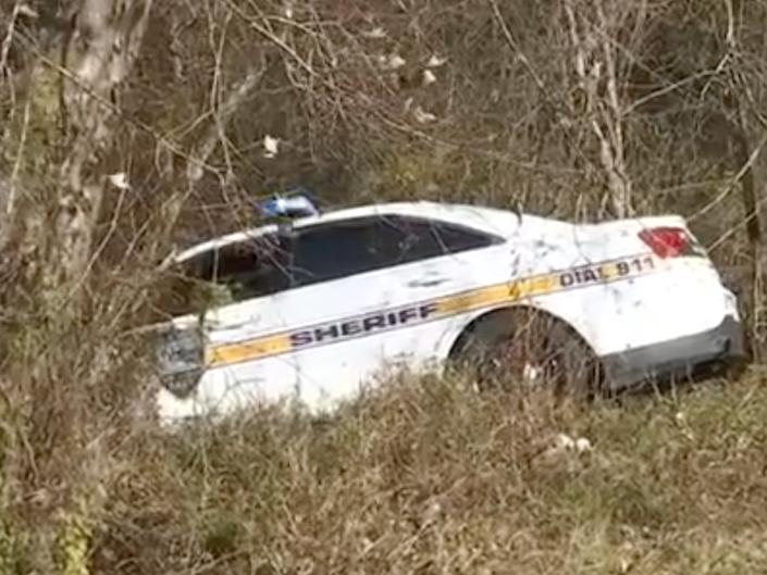 <p>The marked police car allegedly crashed by Joshua Shenker on Thursday 21 January 2021</p> ((WJXT))