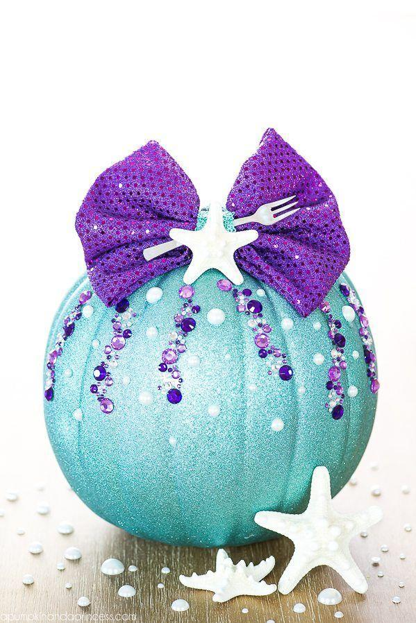 """<p>Spend your Halloween under the sea — or at least play pretend — by adding this glitzy pumpkin to your front stoop, complete with whozits and whatzits galore.</p><p><em><a href=""""https://apumpkinandaprincess.com/diy-no-carve-little-mermaid-pumpkin/"""" rel=""""nofollow noopener"""" target=""""_blank"""" data-ylk=""""slk:Get the tutorial at A Pumpkin & A Princess »"""" class=""""link rapid-noclick-resp"""">Get the tutorial at A Pumpkin & A Princess »</a></em></p>"""