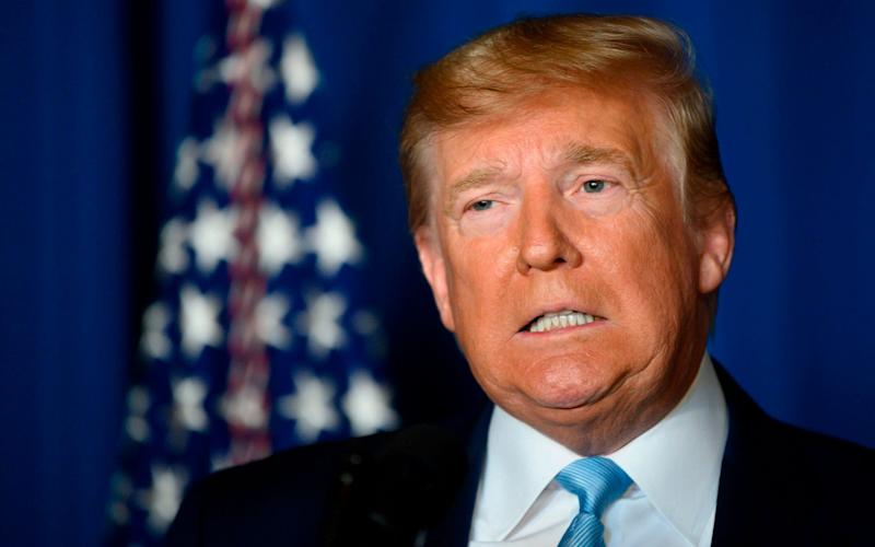 Donald Trump has become only the third US president in history to face a Senate trial over whether to be removed from office - AFP