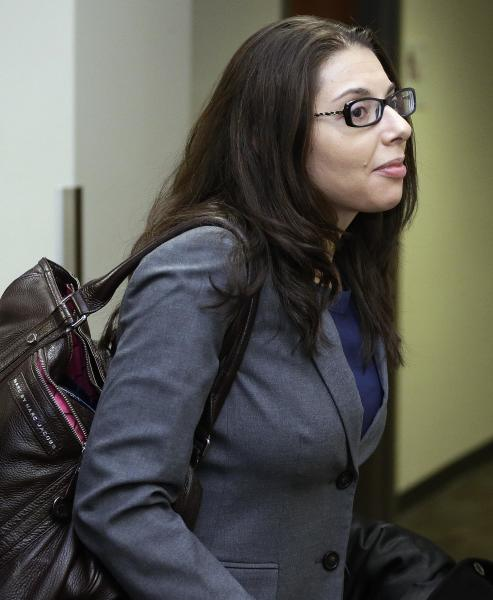 FILE- In this April 1, 2013 file photo, Fox news reporter Jana Winter arrives at district court in Centennial, Colo., where she was subpoenaed to testify about who gave her confidential information about a notebook James Holmes sent to his psychiatrist days before he allegedly opened fire on a crowded movie theater last July, killing 12 people. Winter's lawyers want a New York appeals court to quash a subpoena that requires her to appear at a hearing in Colorado to name her sources cited in her 2012 article. (AP Photo/Ed Andrieski, File)
