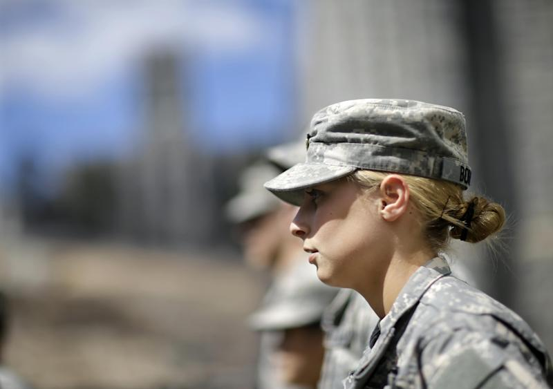In this April 9, 2014 photo, West Point cadet Austen Boroff, of Chatham, N.J., stands in a row of cadets as she waits to march to lunch at the United States Military Academy in West Point, N.Y. With the Pentagon lifting restrictions for women in combat jobs, Lt. Gen. Robert Caslen Jr. has set a goal of boosting the number of women above 20 percent for the new class reporting this summer. (AP Photo/Mel Evans)