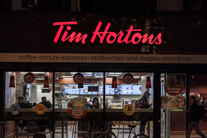 Picture of a sign with the logo of Tim Hortons on their main cafe for downtown Toronto, Ontario, Canada. Tim Horton's is a multinational fast food restaurant known for its coffee and donuts. It is also Canada's largest quick service restaurant chain
