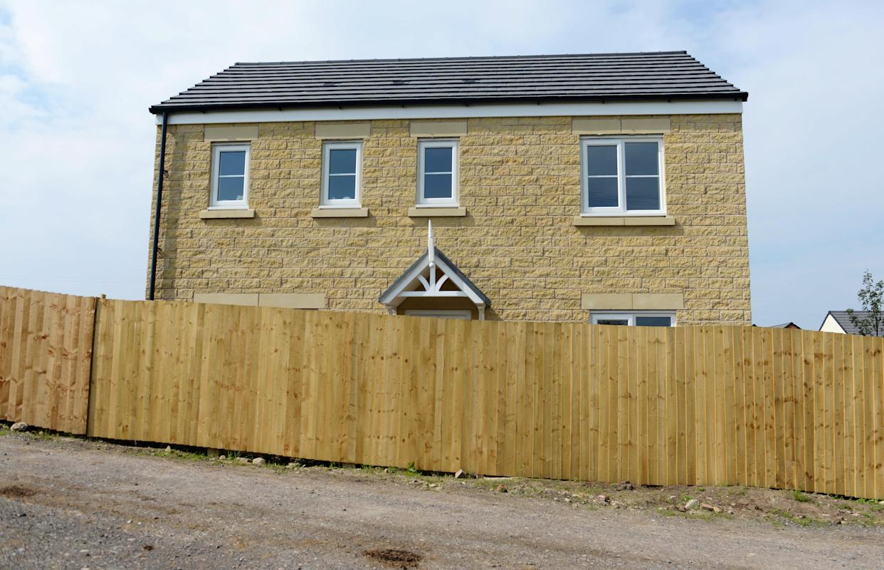 <em>Thomas Entwistle and his wife Rebekah returned from their honeymoon to find a 6ft fence had been put up outside their newly-bought dream home (Picture: SWNS)</em>