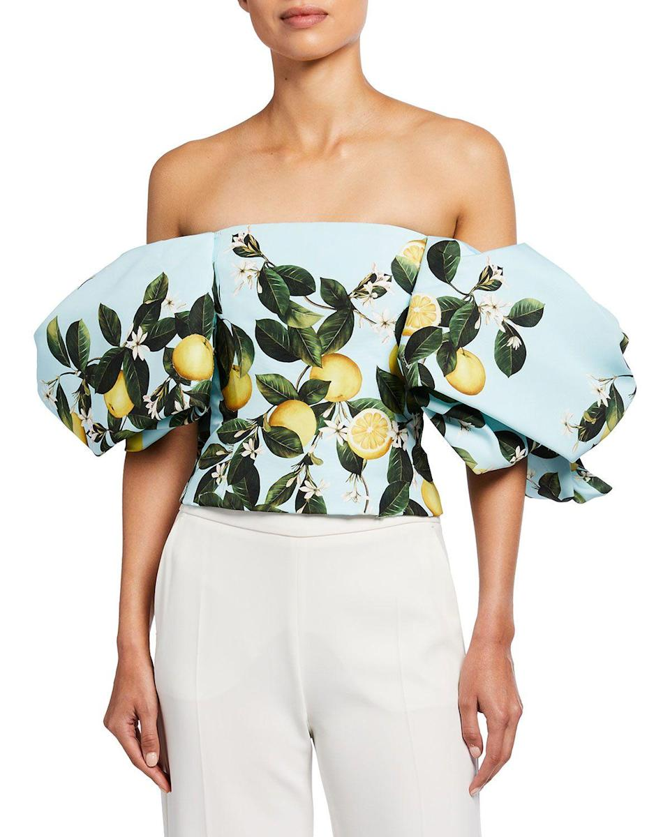 """<p><strong>Oscar de la Renta</strong></p><p>neimanmarcus.com</p><p><strong>$2390.00</strong></p><p><a href=""""https://go.redirectingat.com?id=74968X1596630&url=https%3A%2F%2Fwww.neimanmarcus.com%2Fp%2Foscar-de-la-renta-lemon-print-puff-sleeve-corset-top-prod236710066&sref=https%3A%2F%2Fwww.townandcountrymag.com%2Fsociety%2Ftradition%2Fg36533762%2Flemon-print-fashion-royals-meghan-markle%2F"""" rel=""""nofollow noopener"""" target=""""_blank"""" data-ylk=""""slk:Shop Now"""" class=""""link rapid-noclick-resp"""">Shop Now</a></p><p>The sleeves on this corset top are truly impeccable. We love the drama. </p>"""