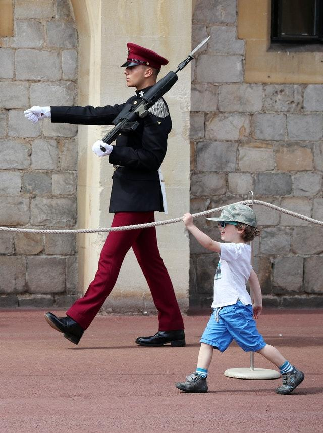 A young visitor marches at Windsor Castle