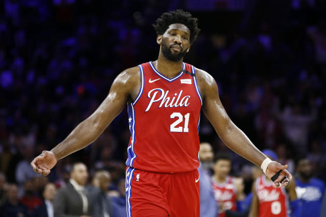 Philadelphia 76ers' Joel Embiid reacts after getting called for a double-technical foul with Los Angeles Clippers' Marcus Morris Sr. during the second half of an NBA basketball game, Tuesday, Feb. 11, 2020, in Philadelphia. (AP Photo/Matt Slocum)
