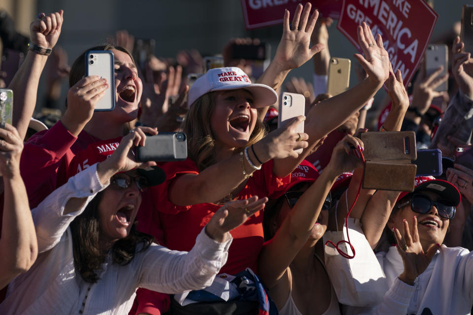 Supporters of President Donald Trump cheer as he walks off stage after speaking during a campaign rally at Phoenix Goodyear Airport, Wednesday, Oct. 28, 2020, in Goodyear, Ariz. (AP Photo/Evan Vucci)